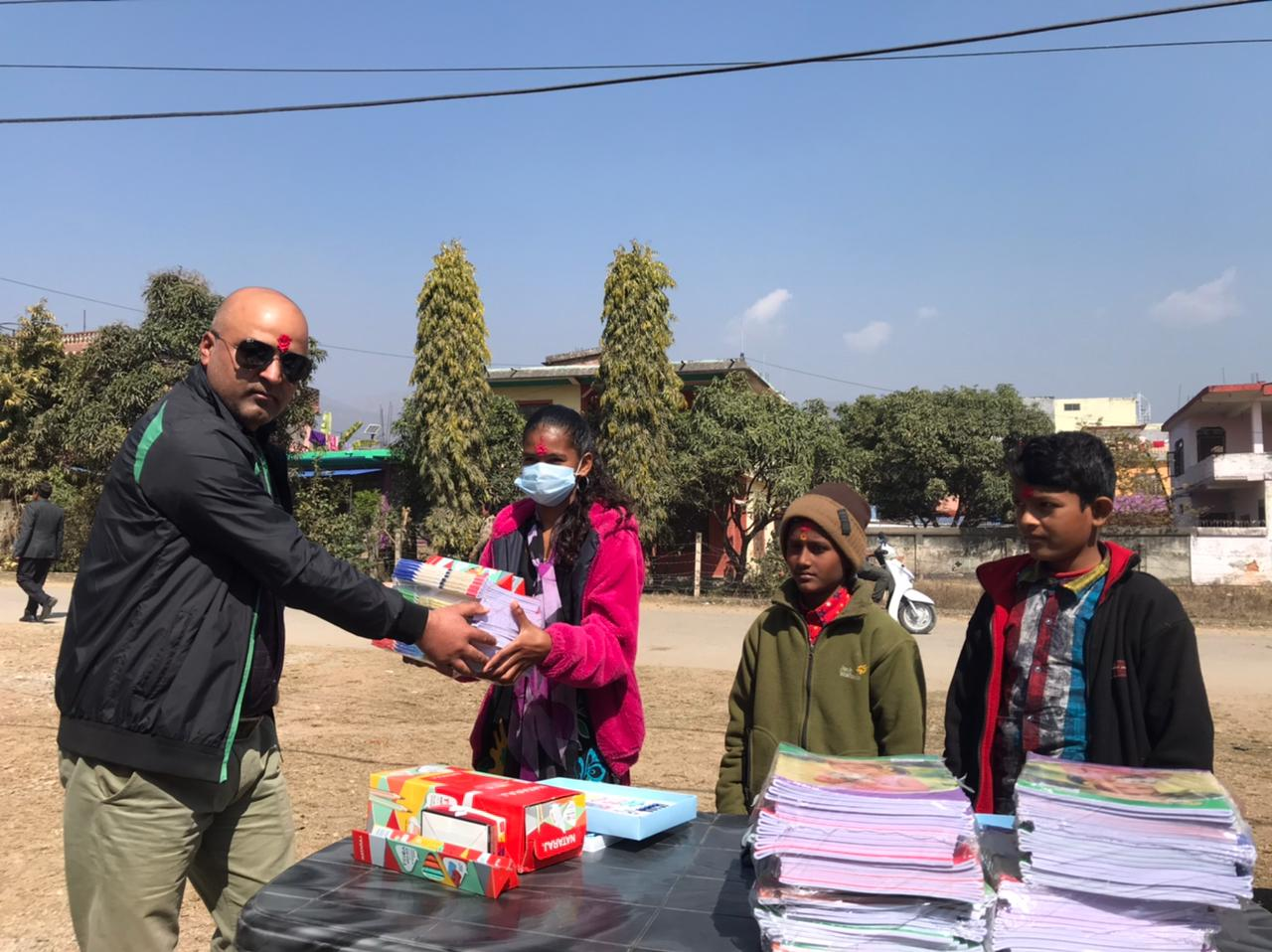 Rossy Foundation Nepal (Asia): Mr Sailendra Bista presenting study materials to students in Nepal.